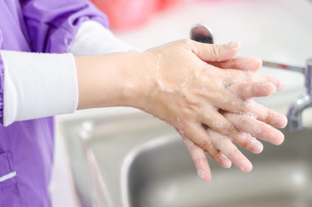 Close up of a healthcare worker's hands covered in soap lather from a Bunzl Cleaning & Hygiene product.