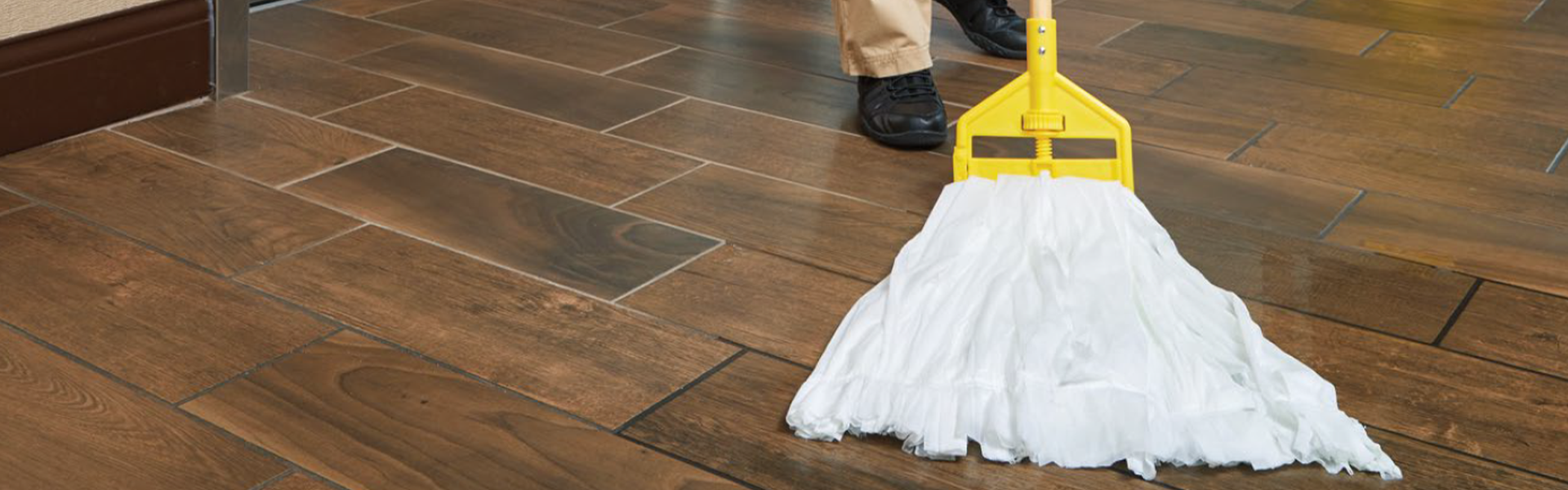 A wet mop cleaning a wood floor.