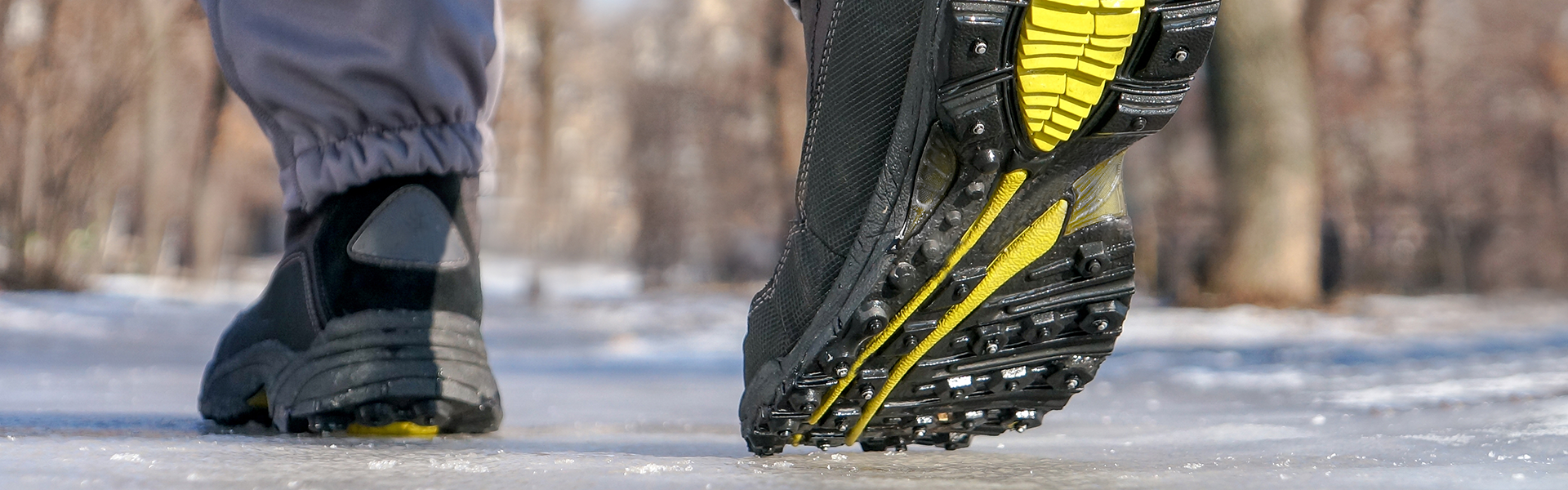 Person with black boots walking on ice.
